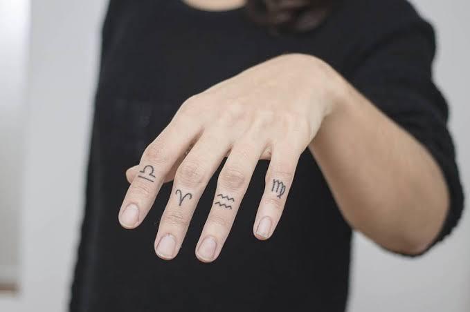 Zodiac Sign Finger Tattoos